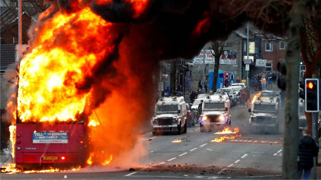 A bus burns in Belfast following rioting