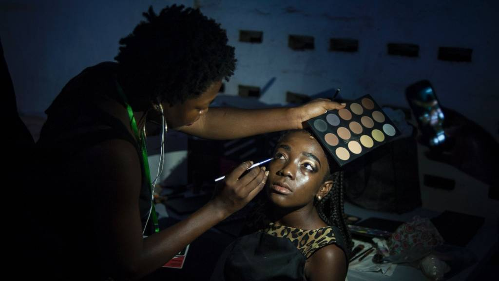 Woman being made up