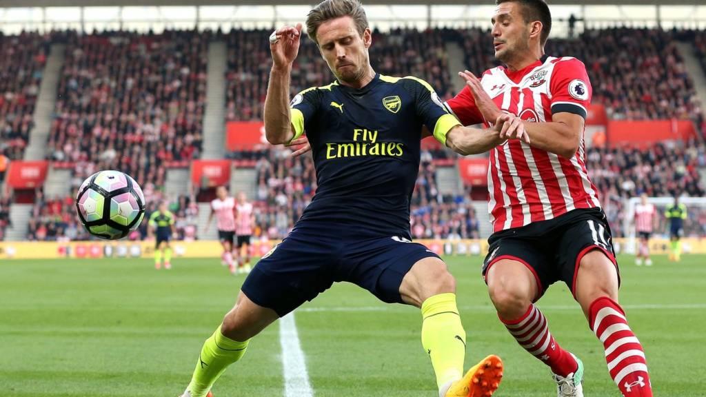 Nacho Monreal of Arsenal and Dusan Tadic of Southampton