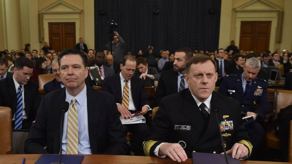 FBI Director James Comey (L) and National Security Agency Director Mike Rogers