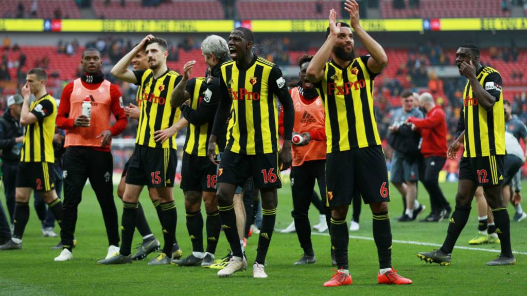Watford players applaud their fans at full-time