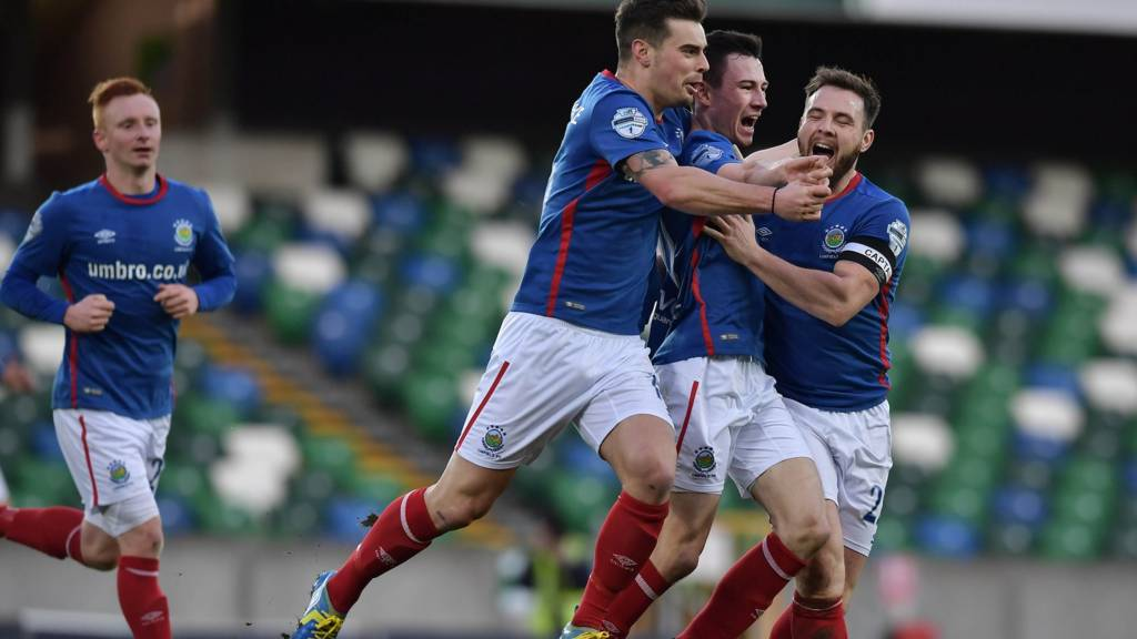 Linfield celebrate a goal against Cliftonville