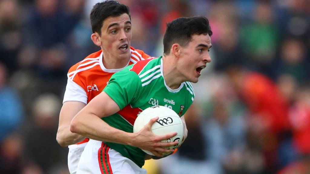 Mayo's Mikey Murray and Rory Grugan of Armagh