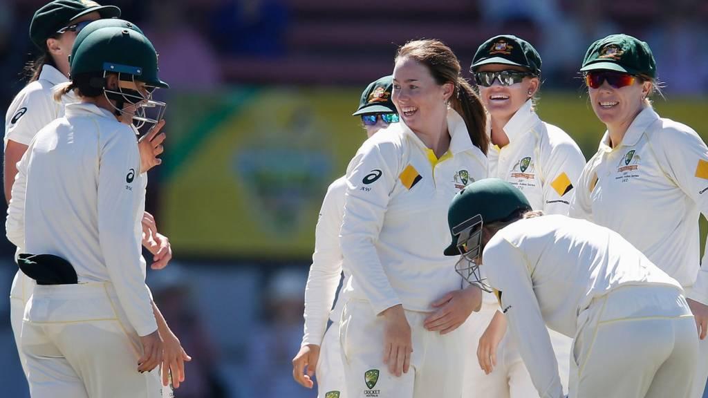 Australia celebrate a wicket by Amanda-Jade Wellington