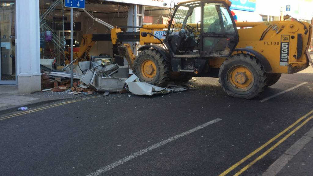 Digger embedded in bank in Leighton Buzzard