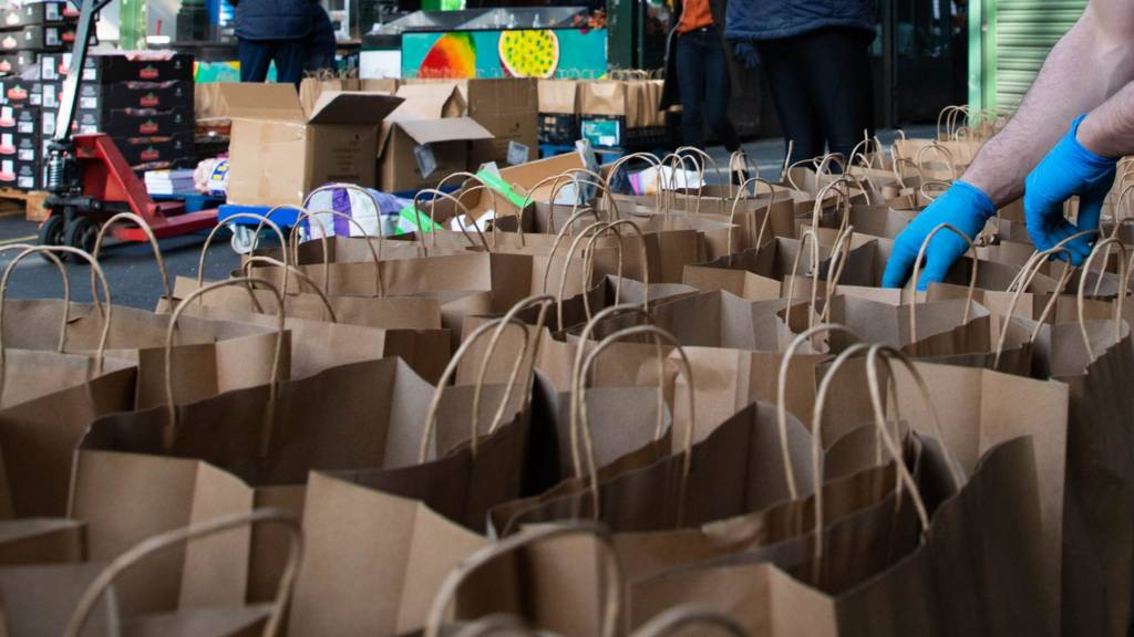 Volunteers help pack bags at Borough Market in London