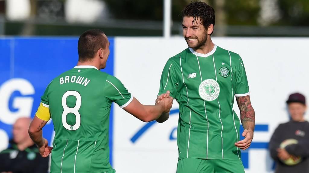 Celtic players Scott Brown and Charlie Mulgrew celebrating
