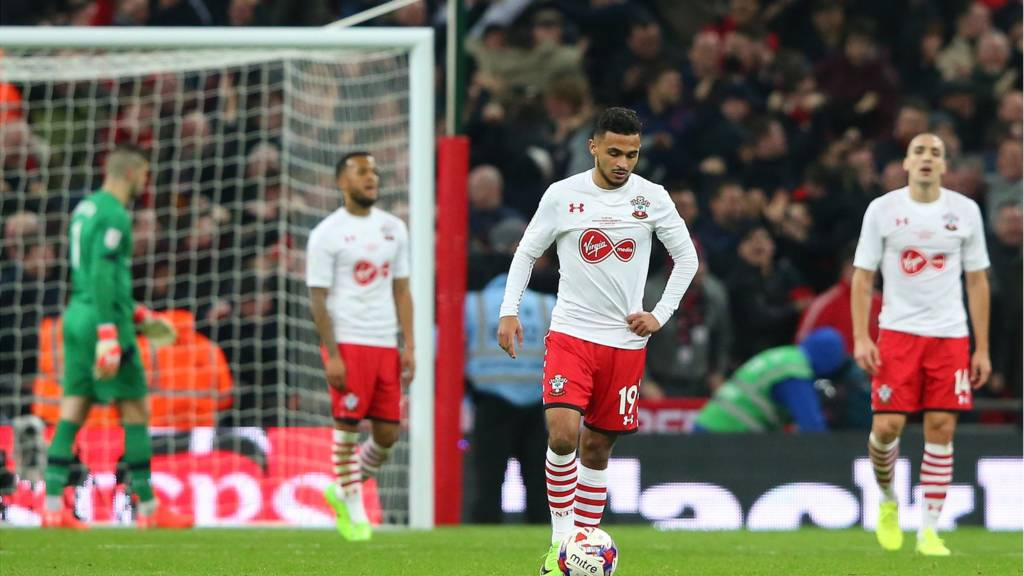 Sofiane Boufal of Southampton and team mates look dejected