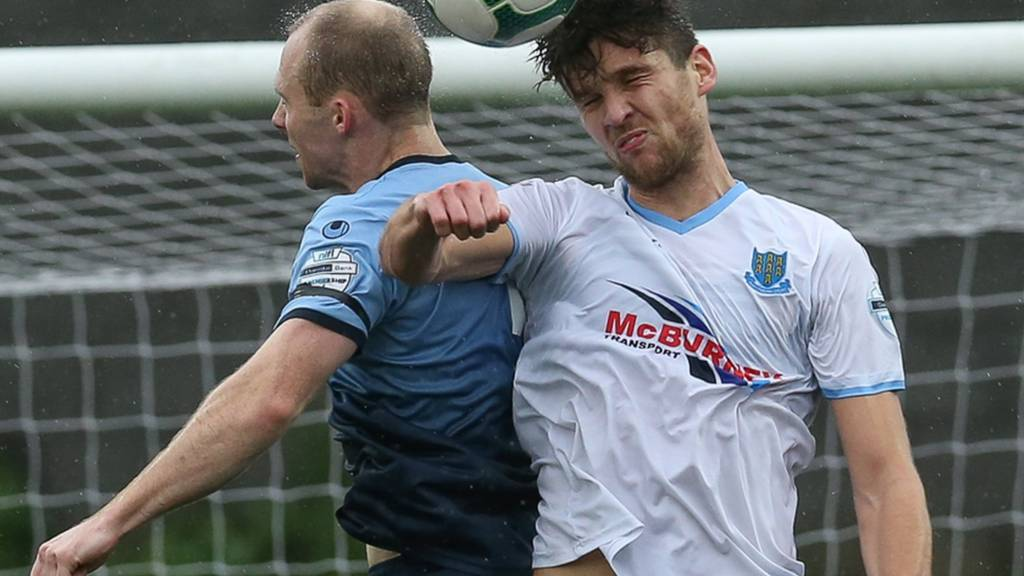 Institute's Dean Curry and Ballymena striker Adam Lecky contest a high ball