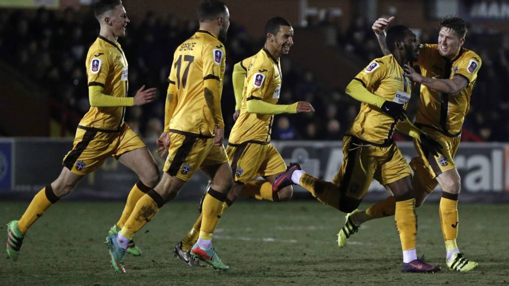 Sutton celebrate scoring their equaliser against Wimbledon