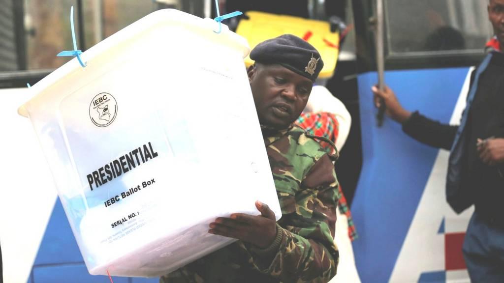A policeman unloads sealed ballot boxes in Nairobi, Kenya