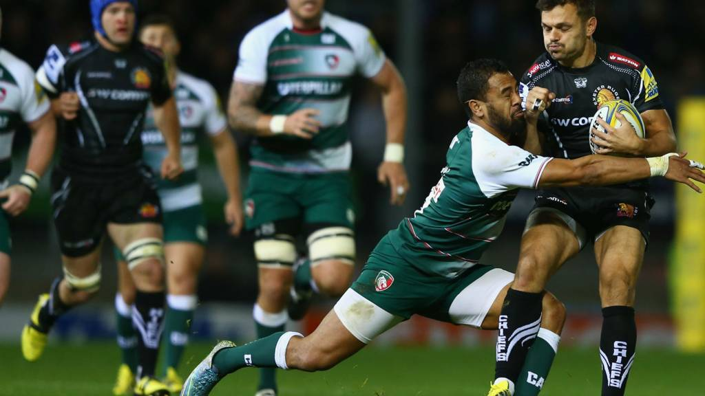 Phil Dollman (R) of Exeter Chiefs is tackled by Telusa Veainu of Leicester Tigers