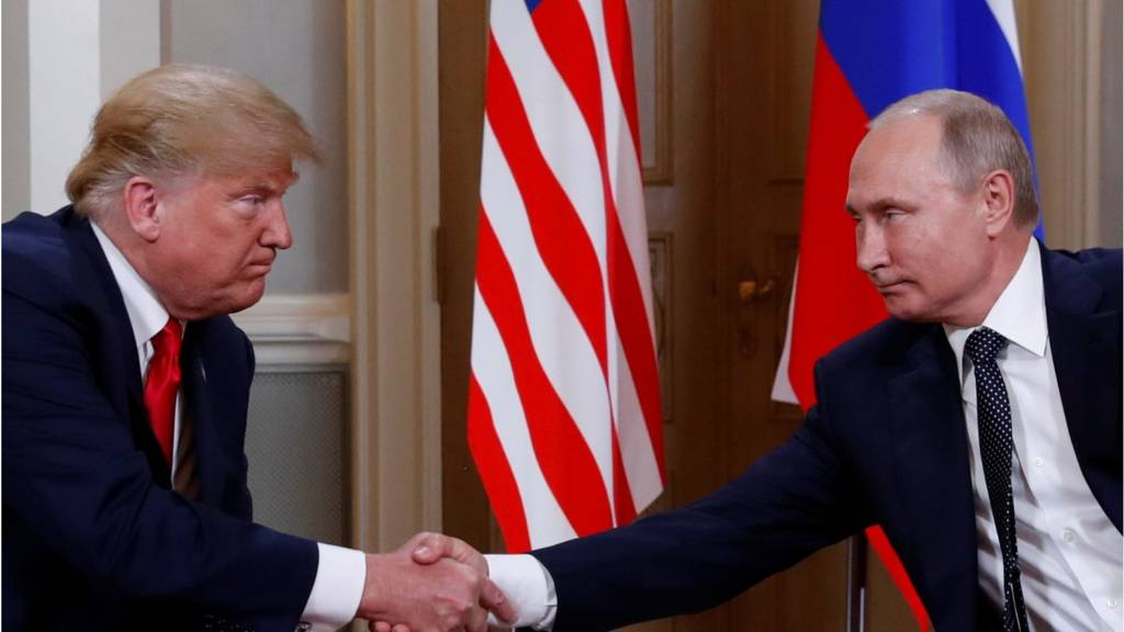 Donald Trump and Vladimir Putin shake hands as the summit begins