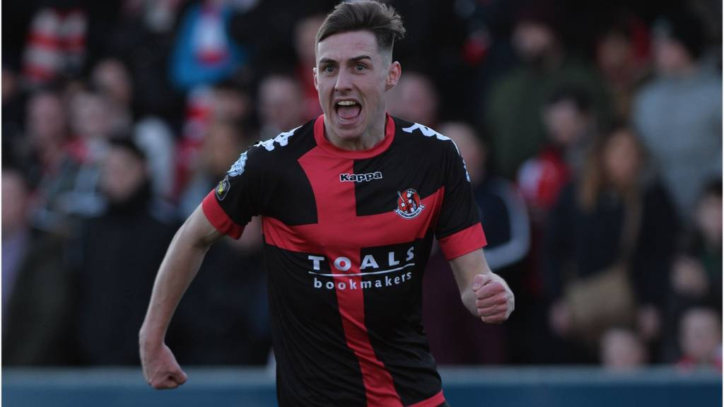 Gavin Whyte celebrates scoring for Crusaders