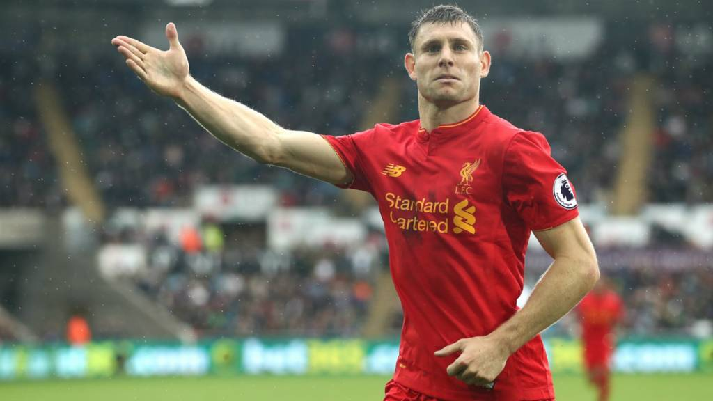 James Milner celebrates