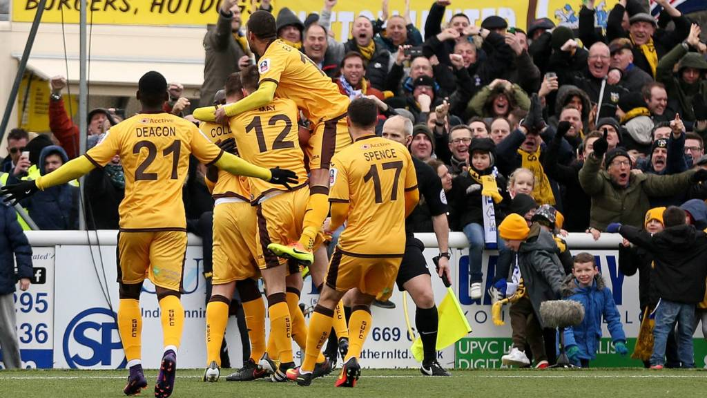 Sutton United players and fans celebrate