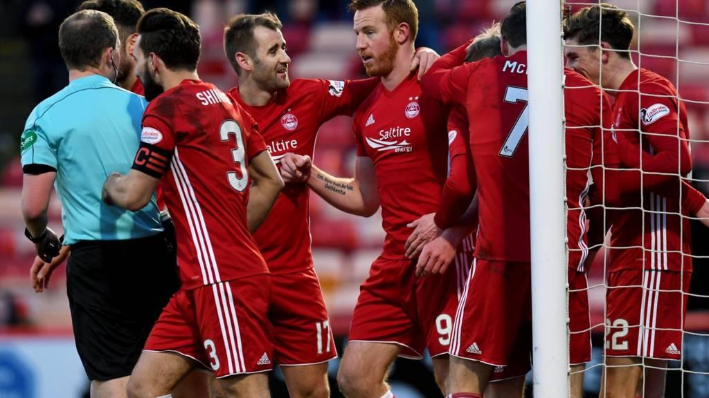 Aberdeen celebrate Adam Rooney's opening goal
