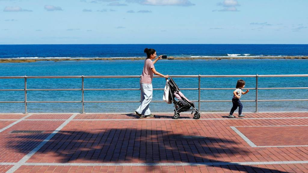Mother and child on promenade, Gran Canaria, Spain
