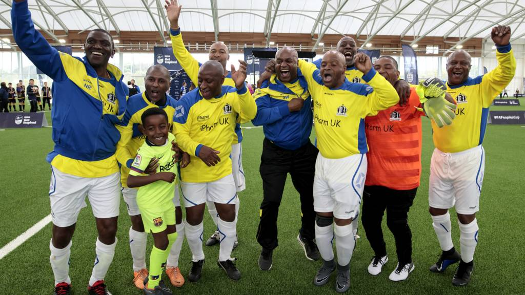 Pele's Pearls football players celebrate after winning their FA People's Cup category