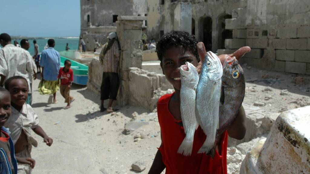 Somali boy with fish