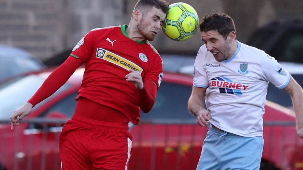 Action from Cliftonville against Ballymena United