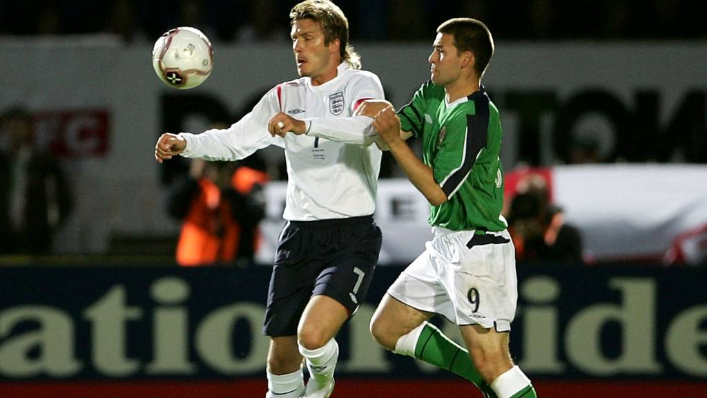 England skipper David Beckham in action against David Healy of England