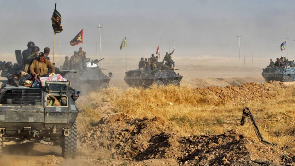Iraqi pro-government forces deploy in the area of al-Shourah, some 45km south of Mosul (17 October 2016)