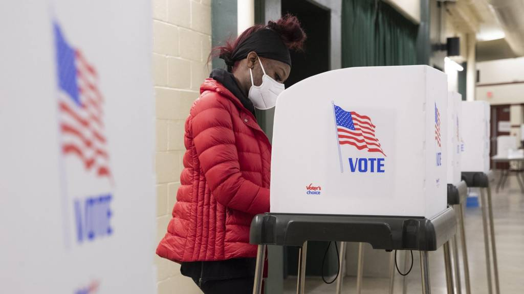 A person stands in a voting booth at a polling location inside Show Place Arena in Upper Marlboro, Maryland, USA, 2 November 2020