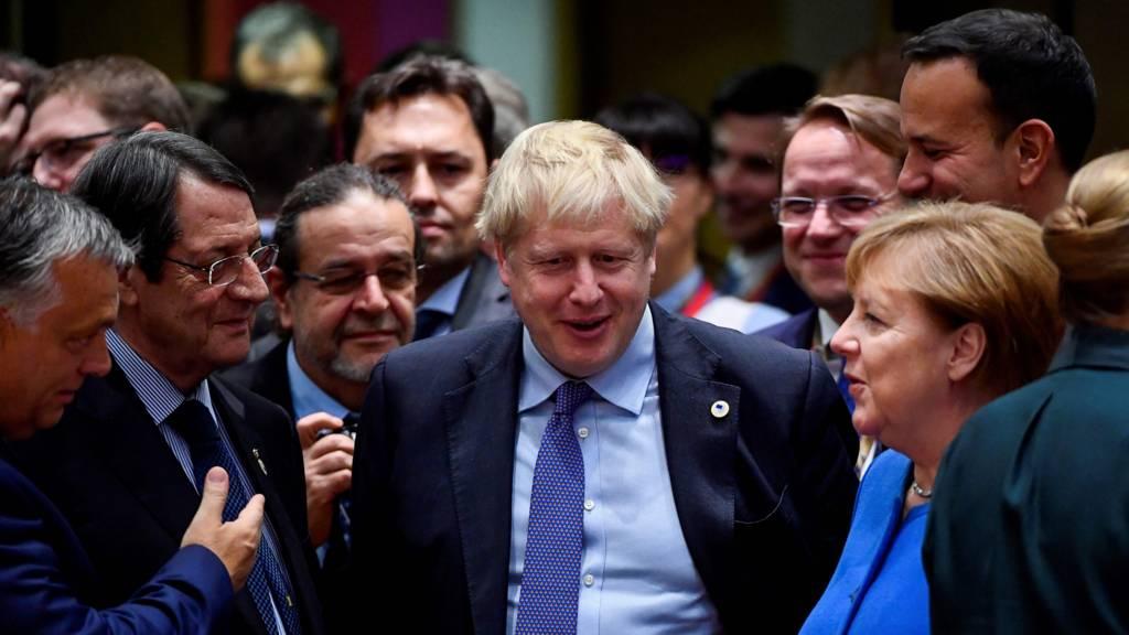 Boris Johnson surrounded by EU leaders