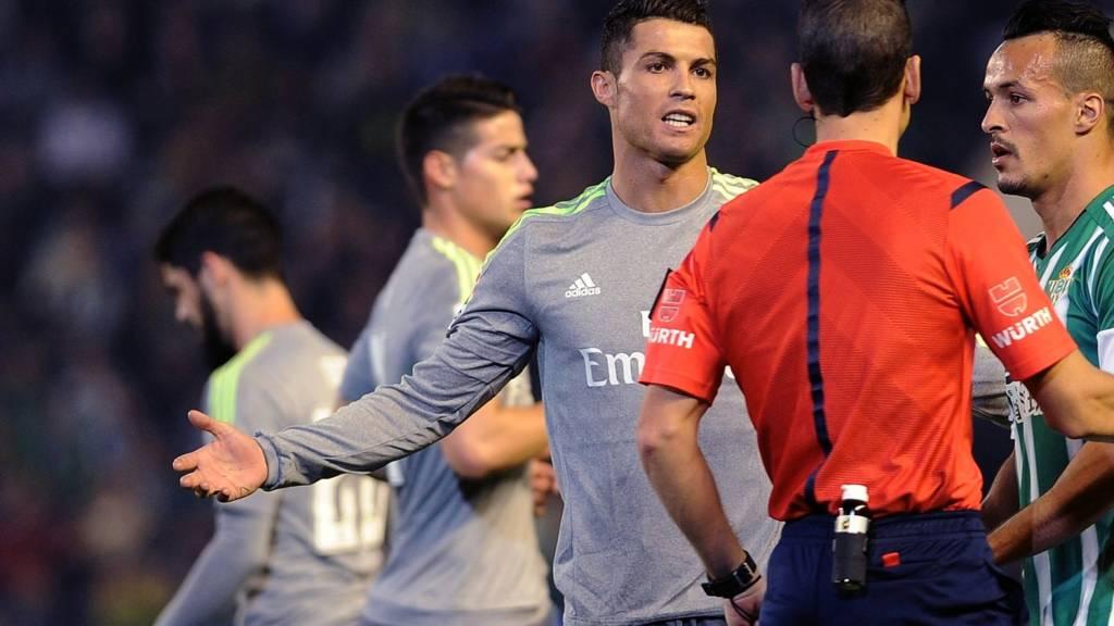 Cristiano Ronaldo of Real Madrid talks to the referee