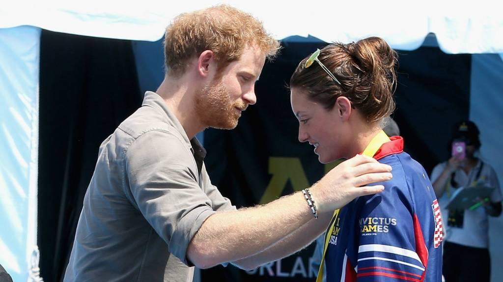Prince Harry presents medal to Sgt Elizabeth Marks