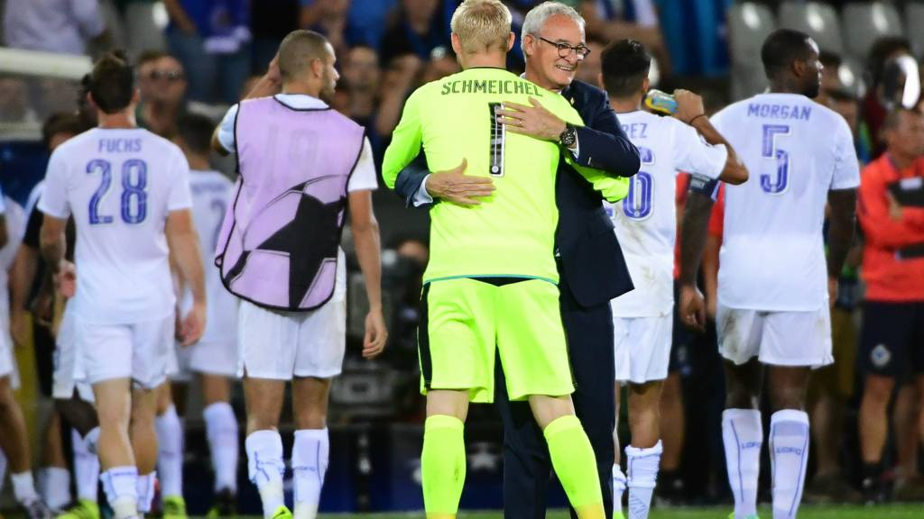 Claudio Ranieri embraces Peter Schmeichel after Leicester victory