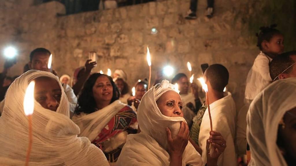 - Ethiopian Christian pilgrims hold candles