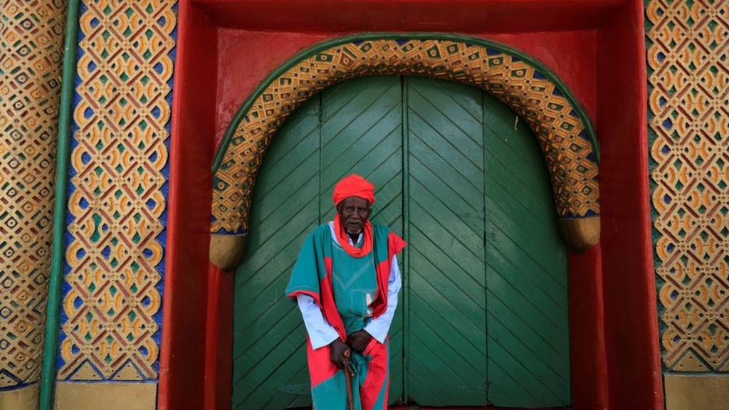 """A palace guard stands in front of the Emir""""s palace before the start of the Durbar festival, on the second day of Eid al-Adha celebration, in Nigeria""""s northern city of Kano September 2, 2017."""
