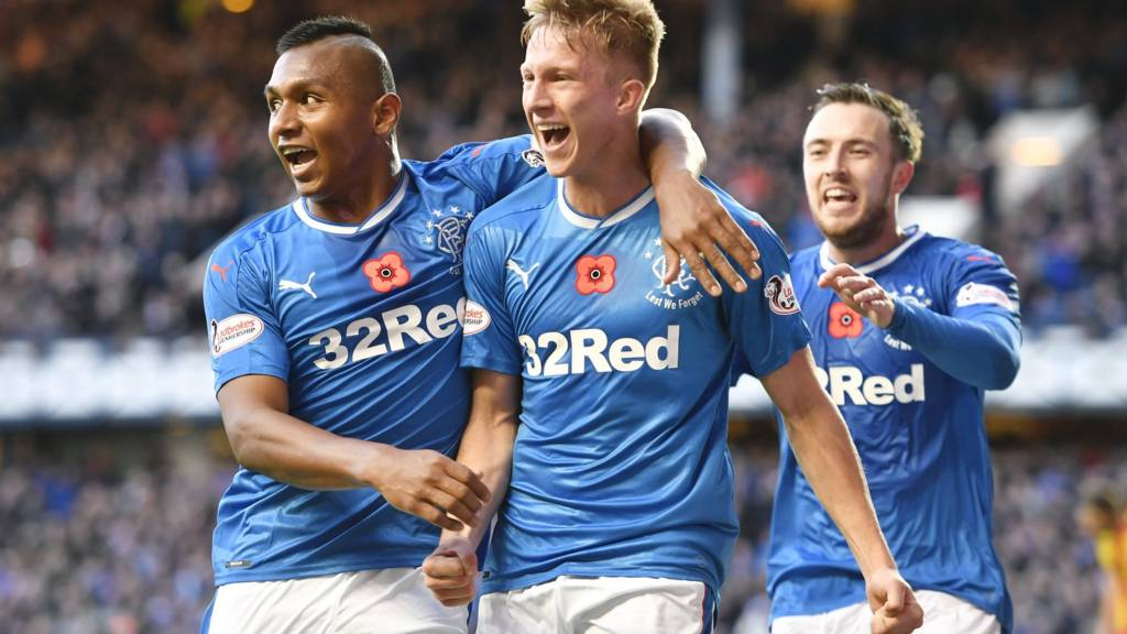 Ross McCrorie celebrates after his header opens the scoring at Ibrox