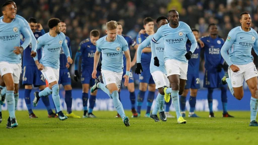 Man City players celebrate victory