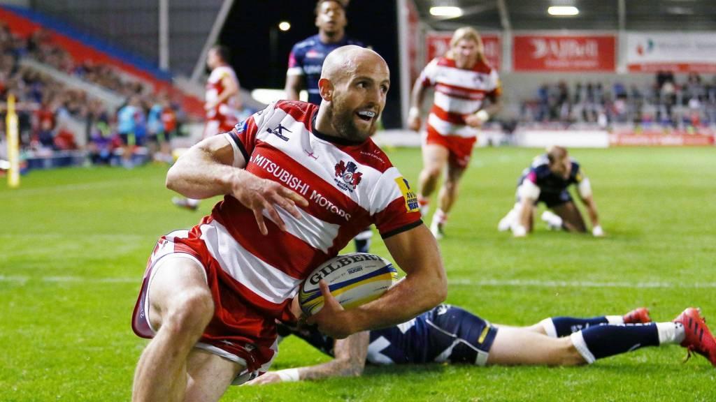 Charlie Sharples celebrates Gloucester try