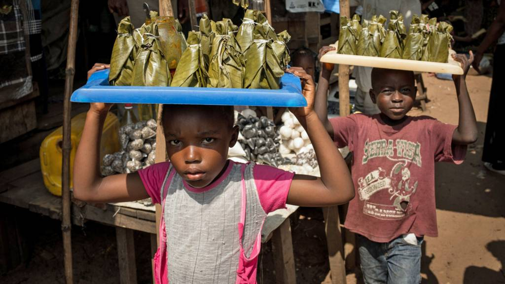 Children sell fish cooked in leaves at a market in Dongo, north-western Democratic Republic of Congo - 2015