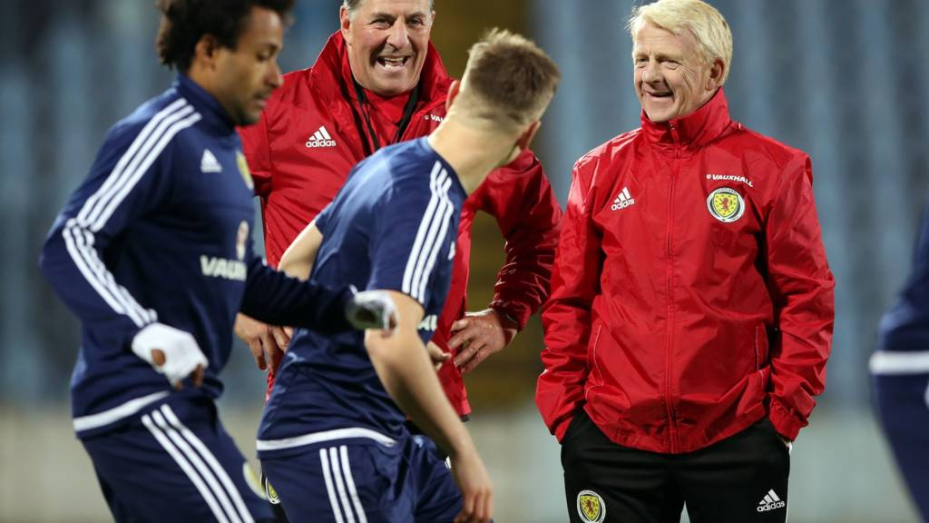 Scotland manager Gordon Strachan shares a joke with assistant Mark McGhee and some of his squad