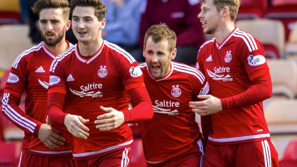 Aberdeen celebrate one of their four goals against Motherwell
