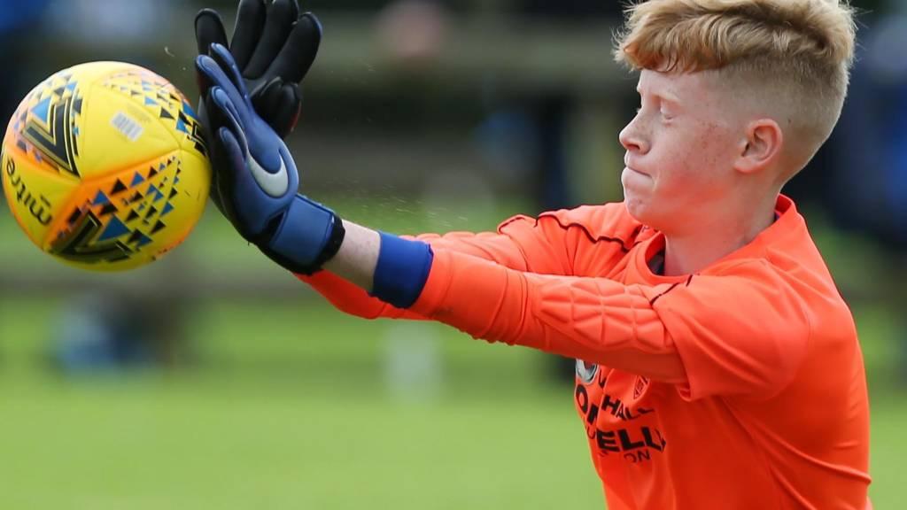 Harry Rainey makes a save for Dungannon Swifts against Ballinamallard