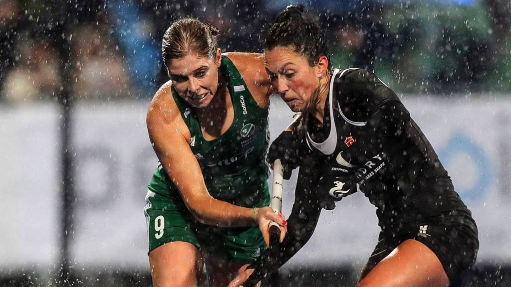 Ireland captain Katie Mullan battles with Canada's Danielle Hennig in Saturday's goalless draw first leg at a rain-lashed Donnybrook on Saturday