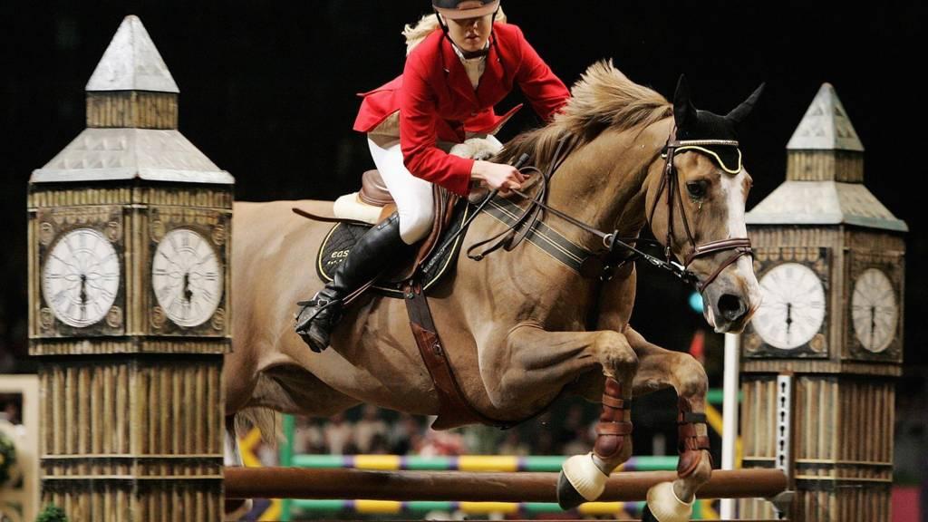 Ellen Whitaker of Great Britain jumps