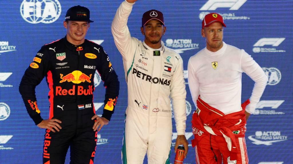 Mercedes's Lewis Hamilton, Red Bul's Max Verstappen and Ferrari's Sebastian Vettel