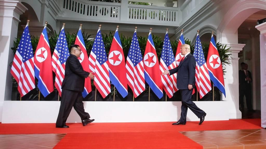 Kim Jong-un and Donald Trump shake hands