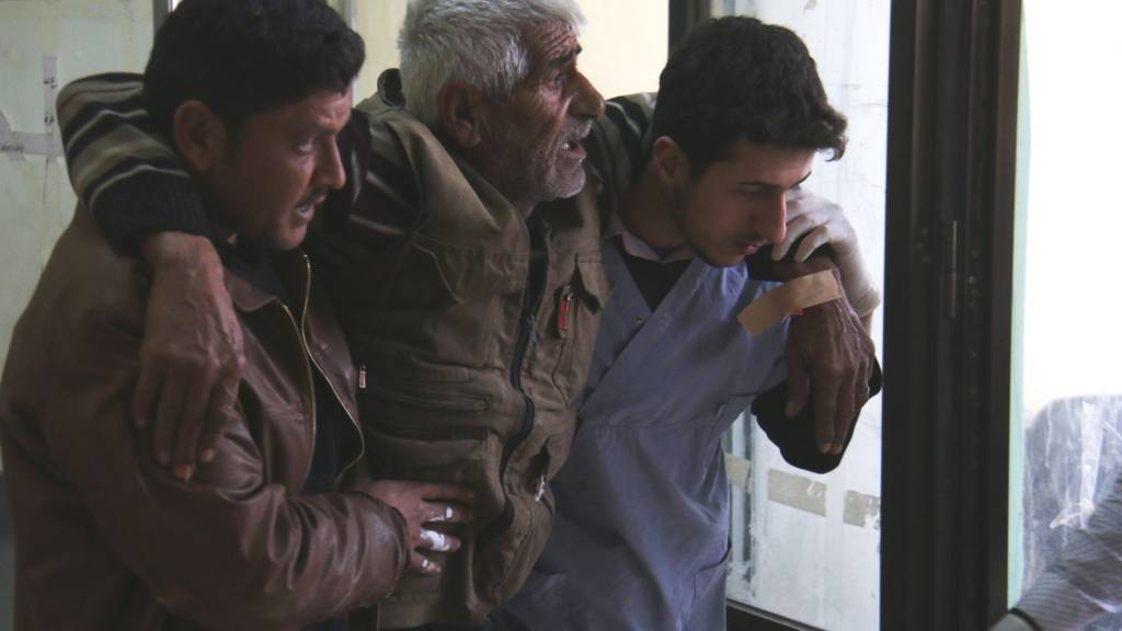 Syrian man receives treatment at a makeshift hospital in Azaz