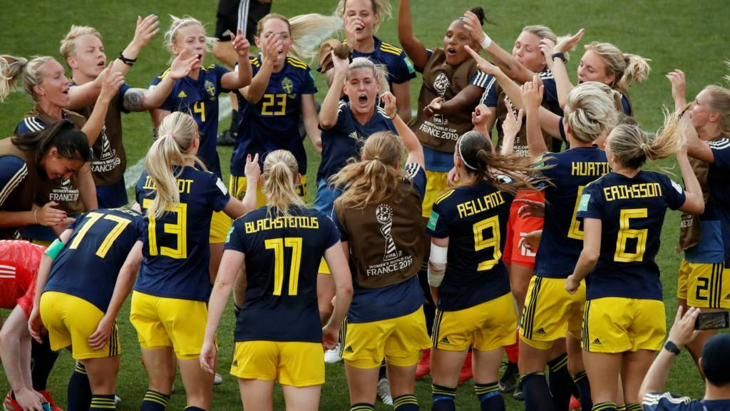 Sweden players celebrate after full-time