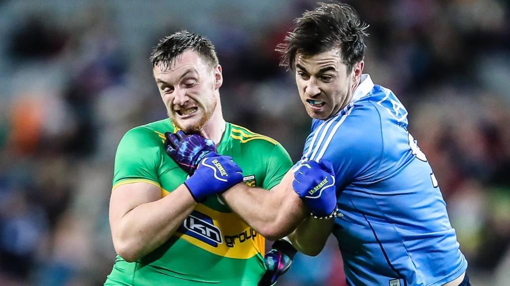 Donegal's Leo McLoone battles with Dublin's Michael Darragh Macauley