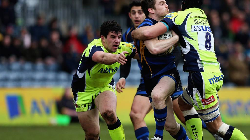 Josh Beaumont of Sale Sharks tackles Tom Heathcote of Worcester Warriors