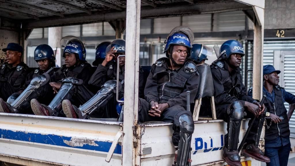 Police wait in a truck